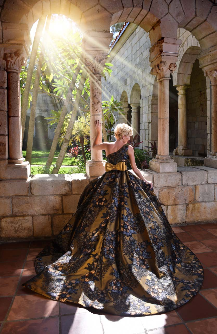 Long gold dress with black floral overlay